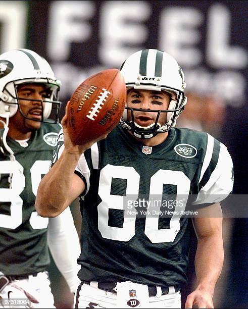 New York Jets Wayne Chrebet shows he's on the ball after third quarter touchdown against the Carolina Panthers at Giants Stadium Jets won 4821