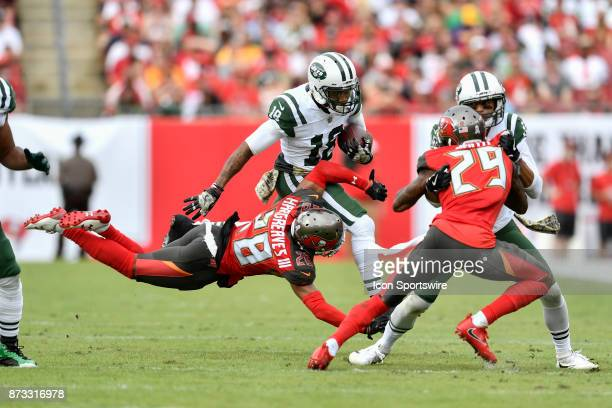 New York Jets wide receiver ArDarius Stewart is tackled by a diving Tampa Bay Buccaneers cornerback Vernon Hargreaves III on the jet sweep during the...