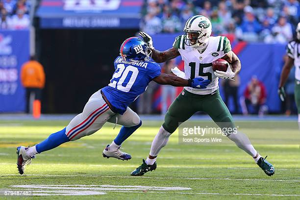New York Jets wide receiver Brandon Marshall tries to get around New York Giants cornerback Prince Amukamara during the first quarter of the game...