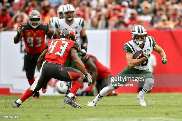 New York Jets wide receiver Chad Hansen tries to cut away from Tampa Bay Buccaneers safety TJ Ward during the second half of an NFL game between the...