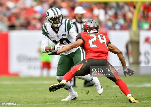 New York Jets wide receiver Jermaine Kearse tries to evade Tampa Bay Buccaneers cornerback Brent Grimes after a reception during the second half of...