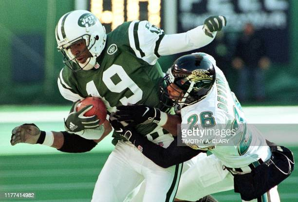 New York Jets wide receiver Keyshawn Johnson is tackled by Jacksonville Jaguars defender Kevin Devine after a pass reception in the second quarter of...