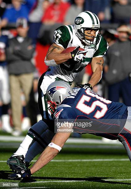 New York Jets wide receiver Laveranues Coles left avoids a tackle by New England Patriots linebacker Mike Vrabel during the first quarter of their...