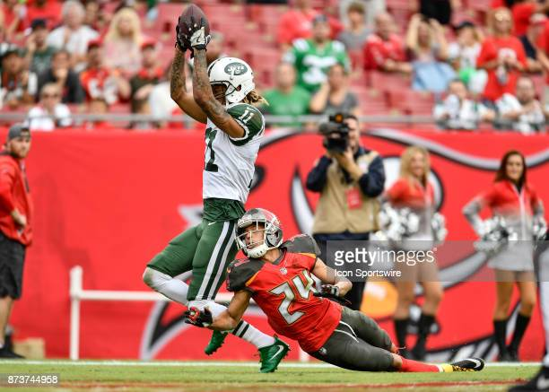 New York Jets wide receiver Robby Anderson catches a touchdown pass while defended by Tampa Bay Buccaneers cornerback Brent Grimes during the second...