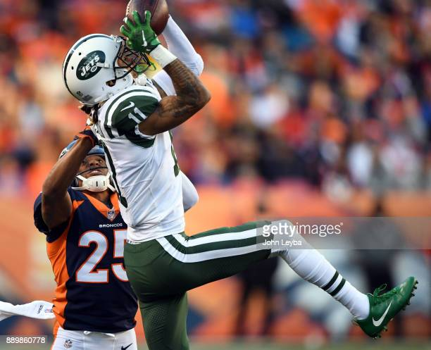 New York Jets wide receiver Robby Anderson goes up for a catch as he gets hit by Denver Broncos cornerback Chris Harris during the third quarter on...