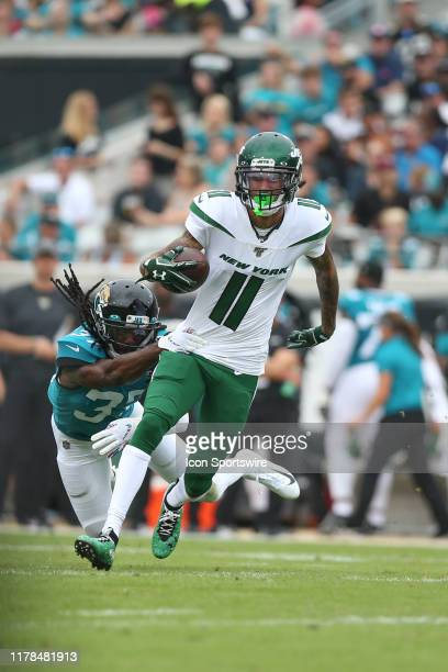 New York Jets Wide Receiver Robby Anderson is tackled by Jacksonville Jaguars Cornerback Tre Herndon during the game between the New York Jets and...