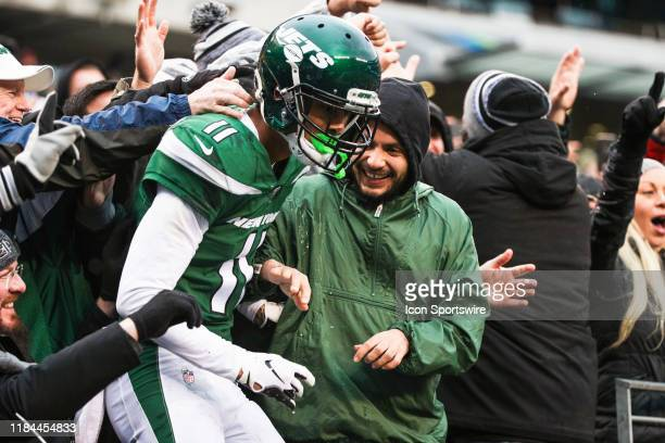 New York Jets Wide Receiver Robby Anderson jumps into the stands after scoring a touchdown during the third quarter of the National Football League...