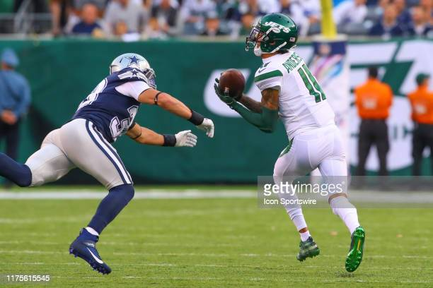 New York Jets wide receiver Robby Anderson makes a 92 yard touchdown catch and run during the second quarter of the National Football League game...