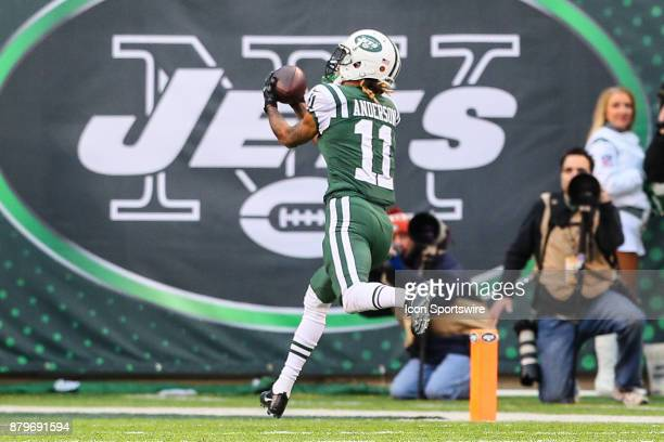 New York Jets wide receiver Robby Anderson makes a catch and run for a touchdown during the National Football League game between the New York Jets...