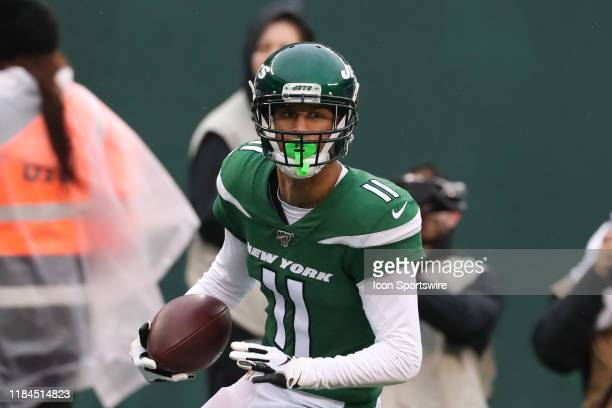 New York Jets wide receiver Robby Anderson makes a catch and run during the second quarter of the National Football League game between the New York...