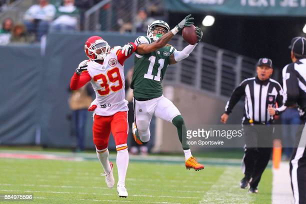 New York Jets wide receiver Robby Anderson makes a catch over Kansas City Chiefs cornerback Terrance Mitchell makes a catch and run during the third...
