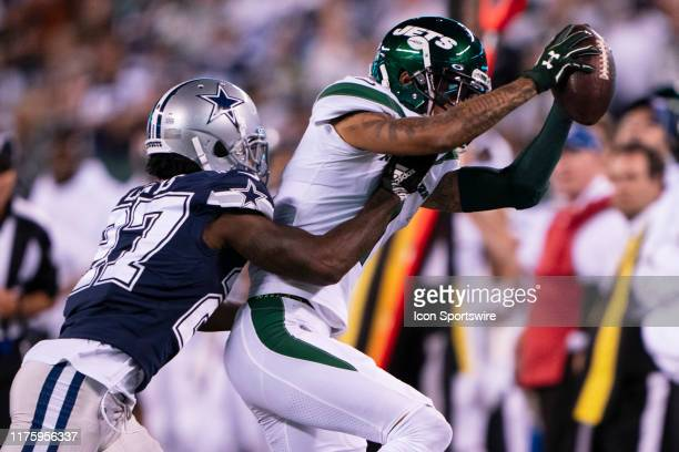 New York Jets Wide Receiver Robby Anderson makes a catch with Dallas Cowboys Cornerbacker Jourdan Lewis defending during the second half of the game...