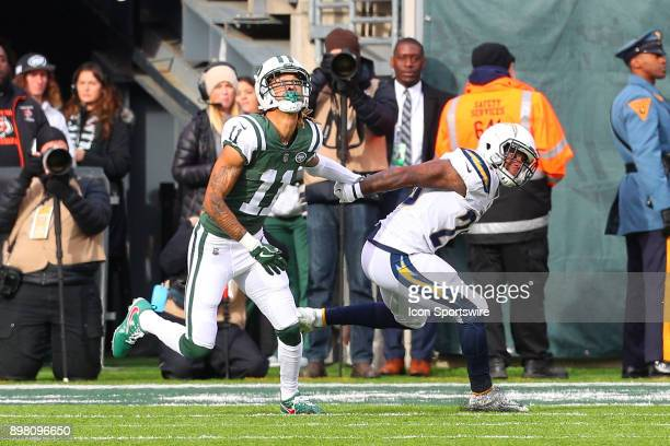 New York Jets wide receiver Robby Anderson pushes off Los Angeles Chargers cornerback Casey Hayward and is called for offensive pass interference...