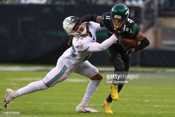 New York Jets wide receiver Robby Anderson runs after the catch during the fourth quarter of the National Football League game between the New York...