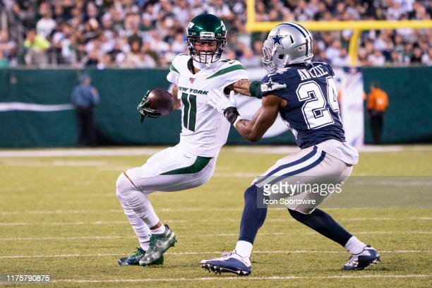 New York Jets Wide Receiver Robby Anderson runs with the ball after a catch with Dallas Cowboys Cornerbacker Chidobe Awuzie defending during the...