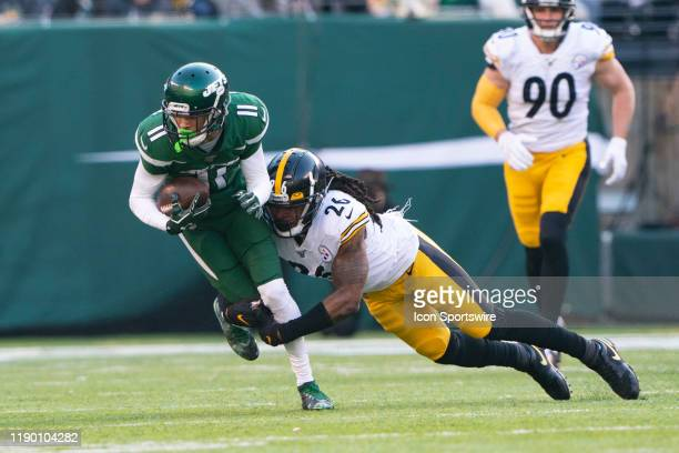 New York Jets Wide Receiver Robby Anderson runs with the ball after making a catch with Pittsburgh Steelers Linebacker Mark Barron defending during...
