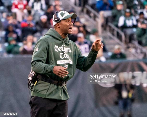 New York Jets Wide Receivers Coach Karl Dorrell speaks to players at a break during the second half of the New England Patriots versus the New York...