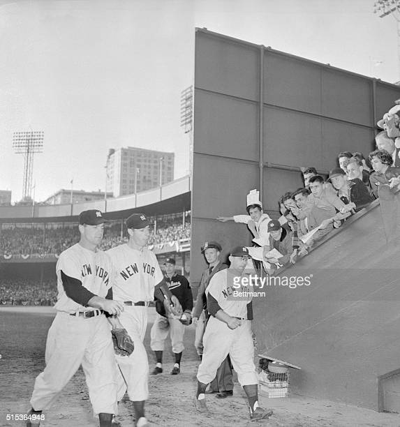Joe Came Through Yankees Joe DiMaggio Hank Bauer and Gene Woodling head for the dressing room at the Polo Grounds after blasting through the Giant's...
