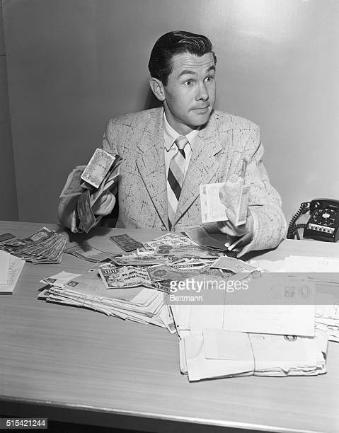 Johnny Carson with some of the money which came pouring in after he jokingly closed his show by staring into the camera and telling the audience that...
