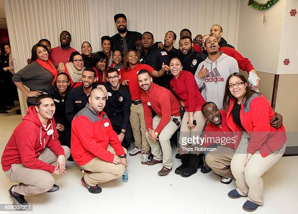 New York Knick Tyson Chandler and his wife Kimberly pose with guests at Tyson And Kimberly Chandler Holiday Shopping Experience At Target on December...