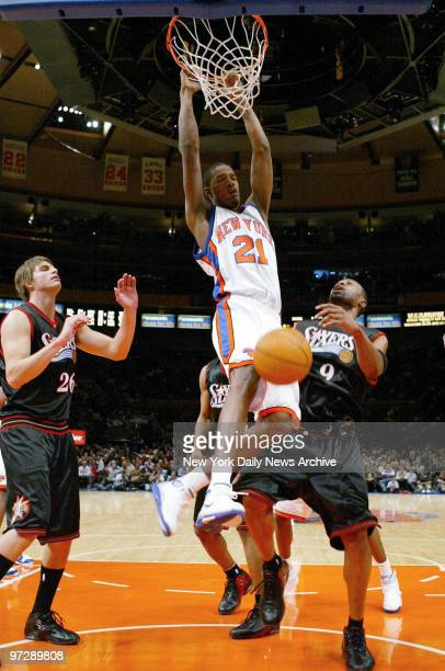 New York Knicks' 19yearold rookie Trevor Ariza dunks the ball for two of his 14 points against the Philadelphia 76ers at Madison Square Garden The...
