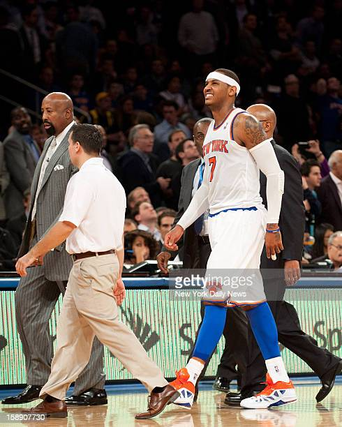 New York Knicks against the Los Angeles Lakers at Madison Square Garden New York Knicks small forward Carmelo Anthony grimaces in pain as he walks...