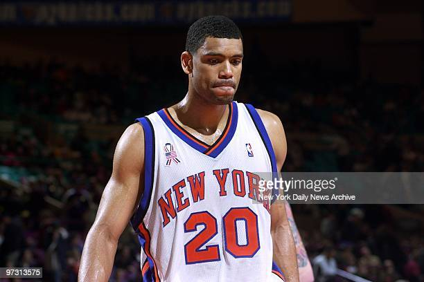 New York Knicks' Allan Houston can see how things are going in the second half against the San Antonio Spurs in Madison Square Garden The Spurs...