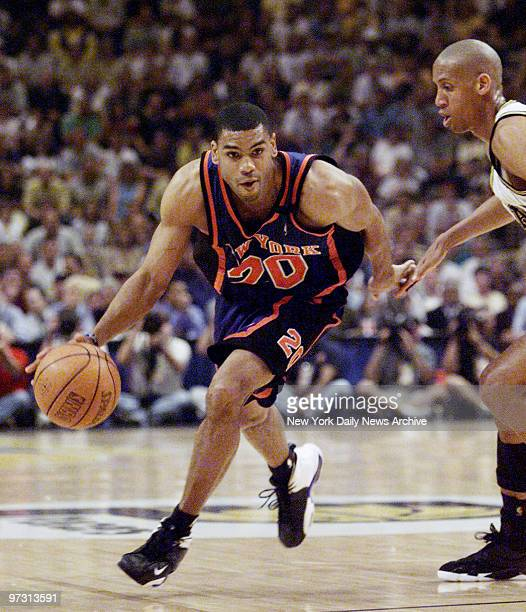 New York Knicks' Allan Houston drives around Indiana Pacers' Reggie Miller during Game 2 of the Eastern Conference finals at Market Square Arena