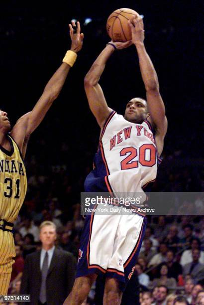 New York Knicks' Allan Houston takes a jump shot over Indiana Pacers' Reggie Miller in Game 6 of NBA Eastern Conference finals at the Garden