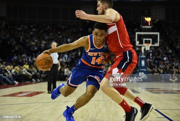 TOPSHOT New York Knicks' Allonzo Trier takes on Washington Wizards' Tomas Satoransky during the NBA London Game 2019 basketball game between...