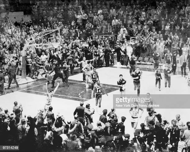 New York Knicks and fans go wild on the court at Madison Square Garden after the team defeated the Los Angeles Lakers to win the NBA Championship