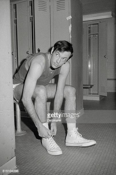 New York Knick's Bill Bradley is photographed here trying on sneakers in dressing room