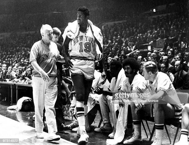 New York Knicks' captain Willis Reed [19] could lend little more than moral support to the Knicks in their decisive 107100 victory over the Los...