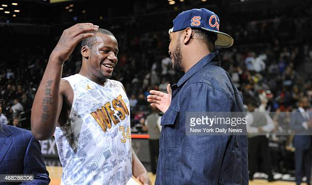New York Knicks Carmelo Anthony and West MVP Cliff Alexander with trophy's after game action of the 2014 Jordan Brand Classic All American game at...