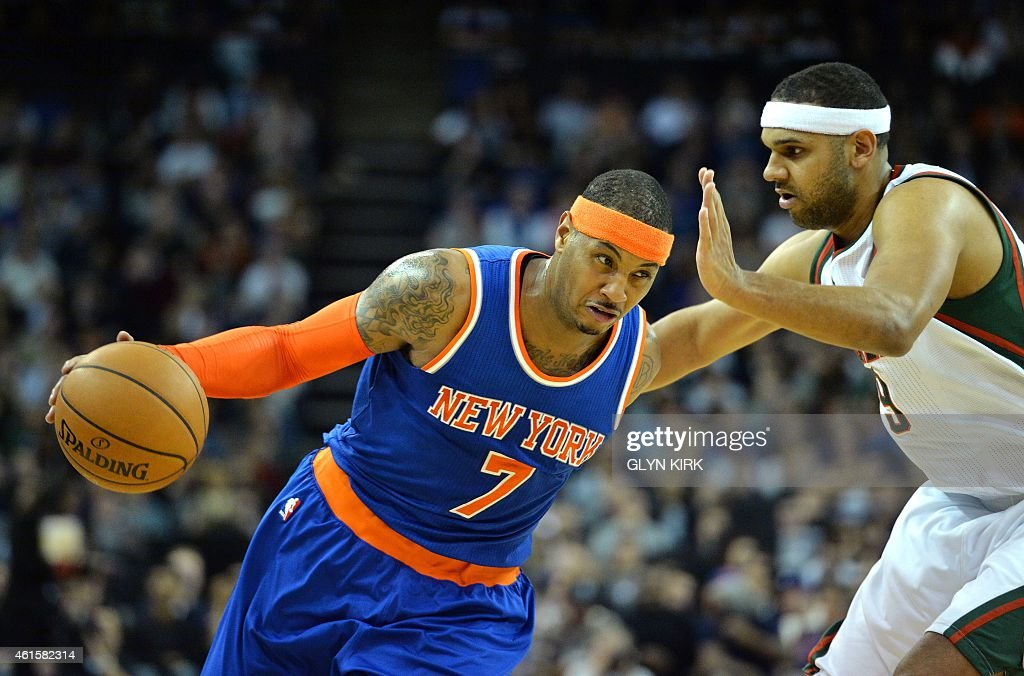 New York Knicks' Carmelo Anthony (L) runs past Milwaukee Bucks' Jared Dudley (R) during the 2015 NBA global game between Milwaukee Bucks and New York Knicks at the O2 Arena in London on January 15, 2015.