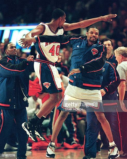 New York Knicks Charlie Ward Kurt Thomas and Latrell Sprewell react as their teammates on the floor take the lead in the third game of their first...