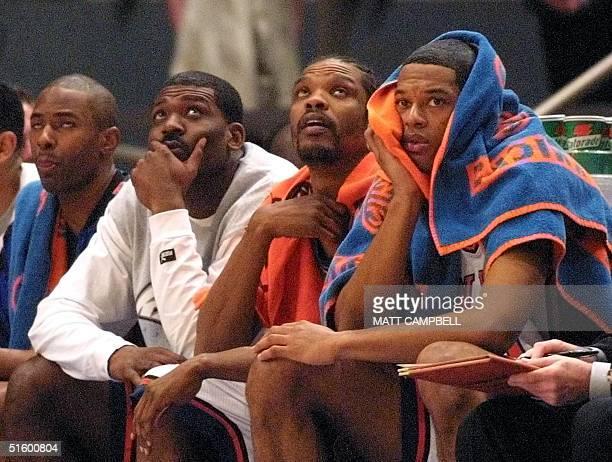 New York Knicks Charlie Ward Larry Johnson Latrell Sprewell and Marcus Camby watch from the bench in the last minutes of the fourth quarter of game...