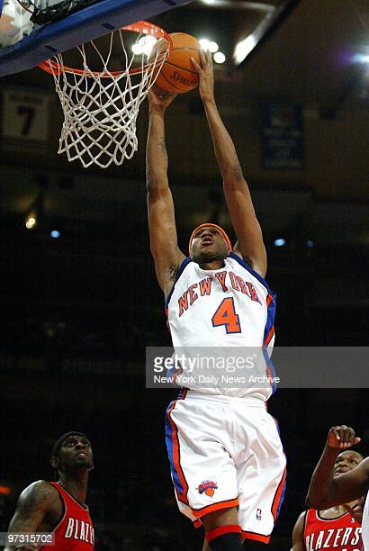 New York Knicks' DerMarr Johnson dunks for two points during game against the Portland Trail Blazers at Madison Square Garden The Knicks edged out...