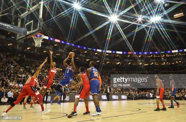 TOPSHOT New York Knicks' Emmanuel Mudiay shoots during the NBA London Game 2019 basketball game between Washington Wizards and New York Knicks at the...