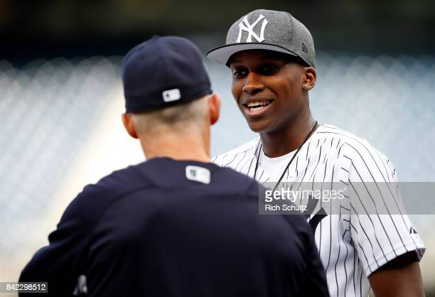 New York Knicks first round draft pick Frank Ntilikina of France talks with manager Joe Girardi of the New York Yankees before a game against the...
