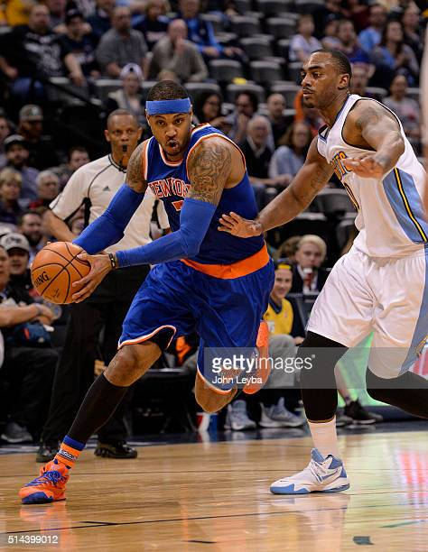 New York Knicks forward Carmelo Anthony drives past Denver Nuggets forward Darrell Arthur during the fourth quarter for an easy layup March 8 2016 at...