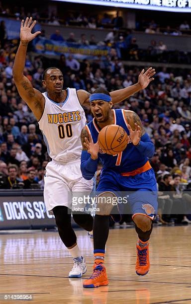 New York Knicks forward Carmelo Anthony reacts as he drives on Denver Nuggets forward Darrell Arthur during the third quarter March 8 2016 at Pepsi...