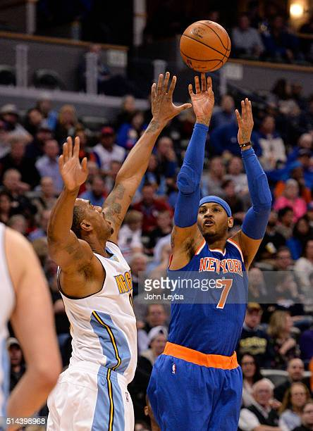 New York Knicks forward Carmelo Anthony takes a shot over Denver Nuggets forward Darrell Arthur during the third quarter March 8 2016 at Pepsi Center