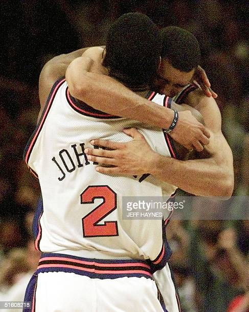 New York Knicks forward Larry Johnson is hugged by teammate Allen Houston 05 June after Johnson made the gamewinning shot of game three of their NBA...