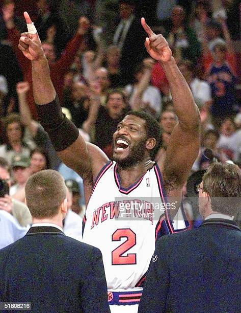 New York Knicks foward Larry Johnson celebrates with the crowd 05 June after game three of the NBA Eastern Conference Finals against the Indiana...