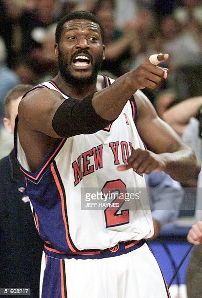 New York Knicks foward Larry Johnson points to the crowd 05 June after game three of the NBA Eastern Conference Finals against the Indiana Pacers at...
