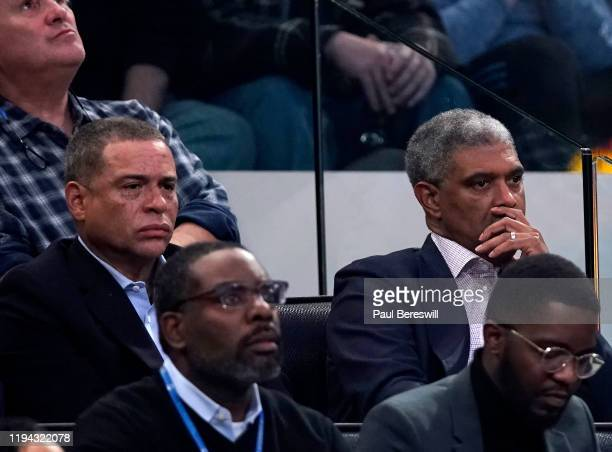 New York Knicks General Manager Scott Perry and President Steve Mills watch the game in their seats at an NBA basketball game between the Knicks and...