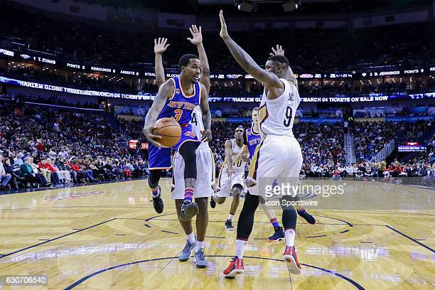 New York Knicks guard Brandon Jennings passes the ball against New Orleans Pelicans forward Terrence Jones during the game between the New Orleans...