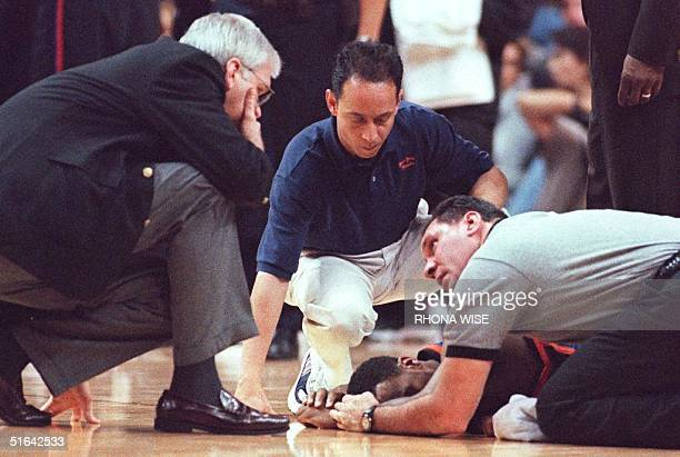 New York Knicks guard Chris Childs is looked at by Knicks trainers and officials after he sustained a concussion during second period action of their...