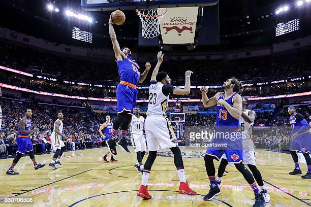 New York Knicks guard Derrick Rose dunks the ball against New Orleans Pelicans forward Anthony Davis during the game between the New Orleans Pelicans...